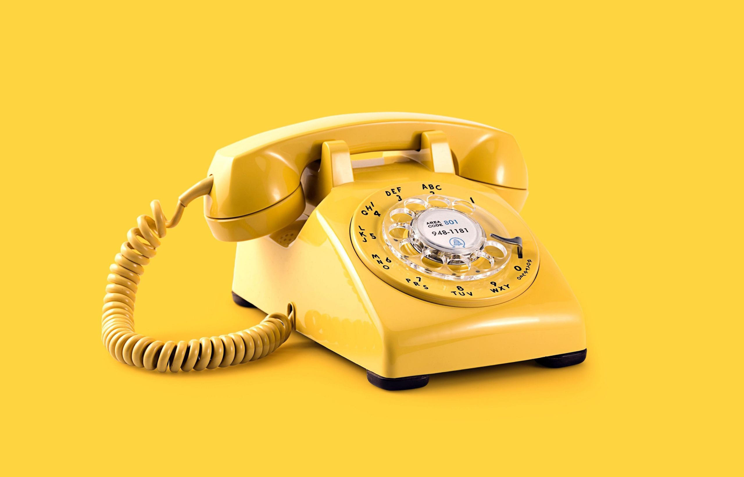 yellow phone on yellow background - sales call tips header
